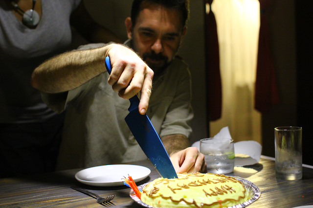 Doug cutting the passion fruit cake.